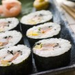 Large Spiral Rolled Sushi with Sushi Ginger Wasabi and Soy Sauce - Stock Photo