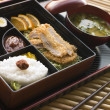 Tonkatsu Box and Miso Soup with Pickles and Sushi on a tray - Stock Photo