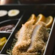 Tonkatsu Box and Miso Soup with Pickles and Sushi - Stock Photo