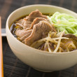 Hot and Sour Beef Broth With Spinach Ramen Noodles - Stock Photo