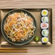 图库照片: Daikon and Carrot Salad with Sesame Sushi and Wasabi