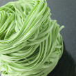 Stack of Spinach Noodles on Black Background — Stock Photo #4754010