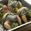 Quails Roasted in Vine Leaves with Lemon and Thyme - Stock Photo