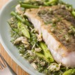 Fillet of Hake with Cockles Green Vegetables and Salsa Verde - Stock Photo
