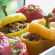 Bell Peppers stuffed with Spiced Rice and Dried Fruits - Stock Photo