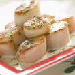 Seared Scallops with Cava Cream and Herb Sauce - Stock Photo