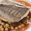 Fillets of Sea Bream with Chorizo Sausage Chickpeas and Tomato S — ストック写真