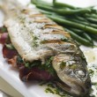 Whole River Trout with Jamon and Herb Butter - Stock Photo
