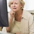 Confused woman frowning at computer monitor — Stock Photo #4754314