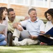 Stockfoto: Adult students sitting on campus lawn