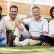 Stock Photo: Adult students sitting on a campus lawn