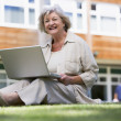 Senior womusing laptop on campus — Foto Stock #4754387