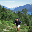 Man hiking in the great outdoors, - Stock Photo