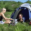 Couple camping in the great outdoors — Stock Photo