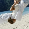 Stock Photo: Couple on swing at beach