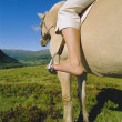 Young woman on horse - Foto de Stock
