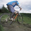 Young man mountain biking — Stock Photo #4754663
