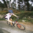 Young woman mountain biking — Stock Photo #4754666