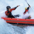 Two paddling inflatable boat down rapids — Stock Photo #4754702