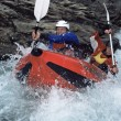 Two paddling inflatable boat down rapids - Lizenzfreies Foto