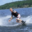 A young man water skiing — Stock Photo