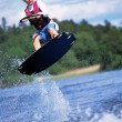 A young woman water skiing — Stock Photo
