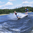 A man and woman water-skiing — Stock Photo #4754726