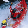 Two paddling inflatable boat down rapids — Stock Photo #4754811