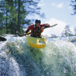 Young man kayaking on waterfall — Stock Photo