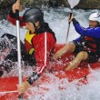 Two paddling inflatable boat down rapids — Stock Photo #4754821
