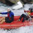 Two paddling inflatable boat down rapids — Stock Photo #4754823