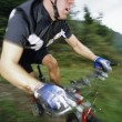 Man mountain biking — Stock Photo