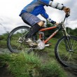 Young man mountain biking — Stock Photo #4754841