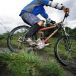 Young man mountain biking — Stock Photo