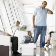 Passengers waiting in airport departure lounge — Stock Photo