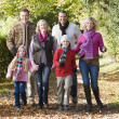Multi-generation family on walk through woods — Stock Photo