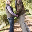 Senior couple on woodland walk — Stockfoto
