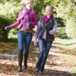 Mother and daughter on walk through woods — Stock Photo