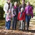 Multi-generation family walking through woods — Stock Photo