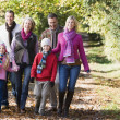 Stock Photo: Multi-generation family walking through woods