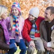 Family on autumn walk — Stock Photo #4754925