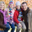 Family on autumn walk - Stock Photo