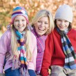Mother and children on autumn walk — Stock Photo #4754927