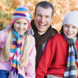 Father and children on autumn walk — Stock Photo #4754930