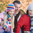 Stock Photo: Father and children on autumn walk