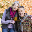 Affectionate senior couple on autumn walk — Stock Photo #4754945