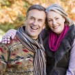 Affectionate senior couple on autumn walk — Stock Photo