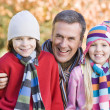 Grandfather and grandchildren on walk — Stock Photo #4754948