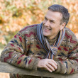 Stock Photo: Senior man resting on fence
