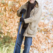 Stockfoto: Man tidying autumn leaves
